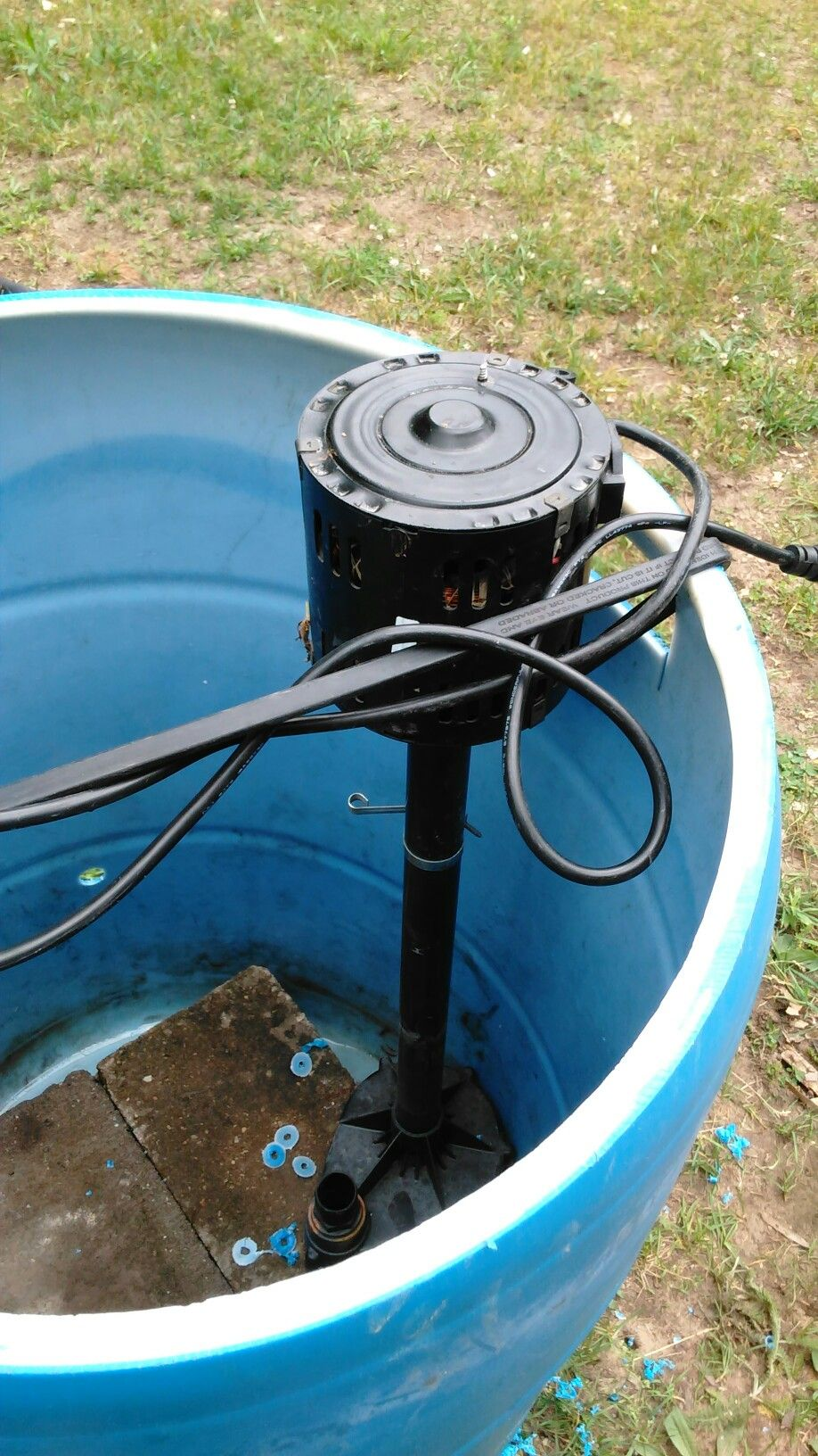 Bungie strap to hold pump in the barrel | Sump pump