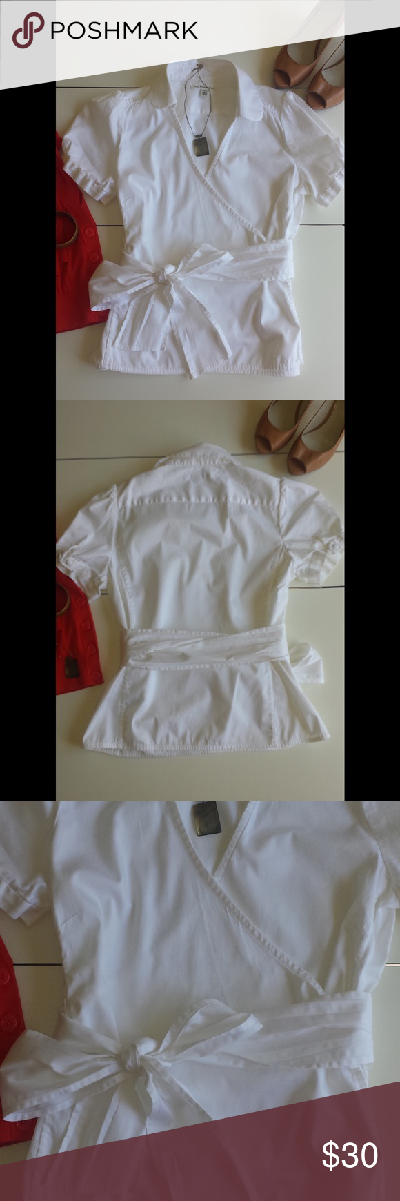 "Banana Republic Wrap Shirt 100% cotton. White wrap shirt. Cute two button detail on the sleeves.  24"" long. In excellent condition with no rips or stains. Banana Republic Tops Blouses"