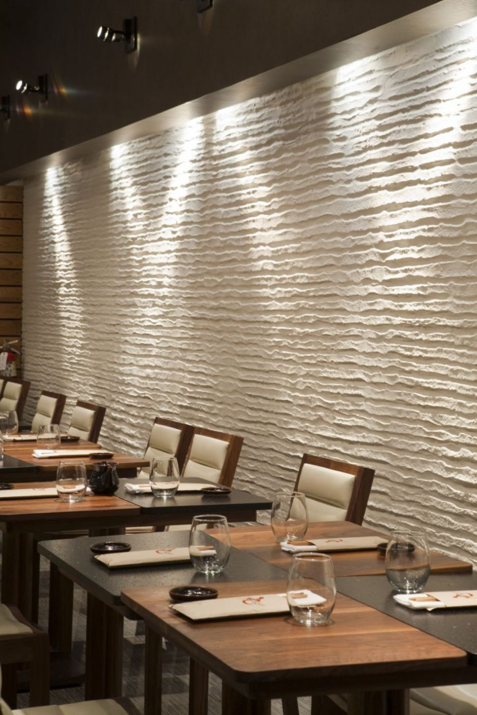 room interior design restaurant with unique white embossed wall treatment decoration with cross wall light decoration living