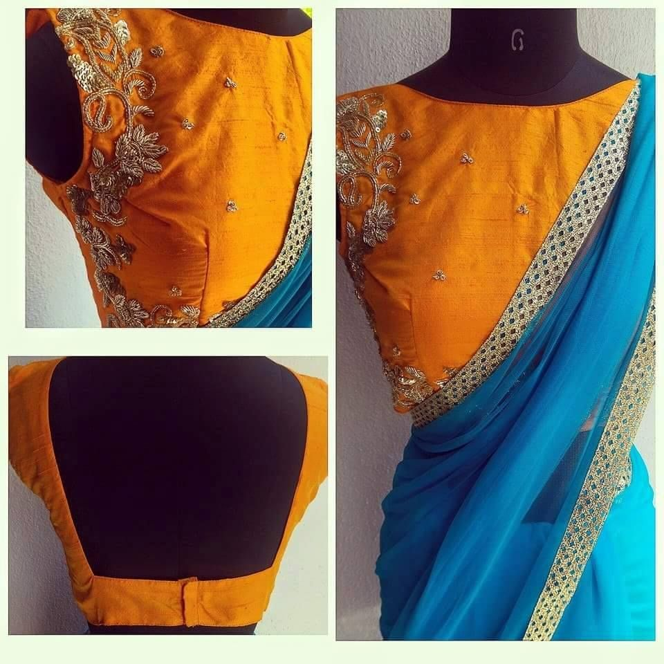 ee14fa30ad636 Beautiful sky blue soft net sari with a popping mango color pure raw silk  blouse hand embroidered in our LUXE design. 08 July 2016