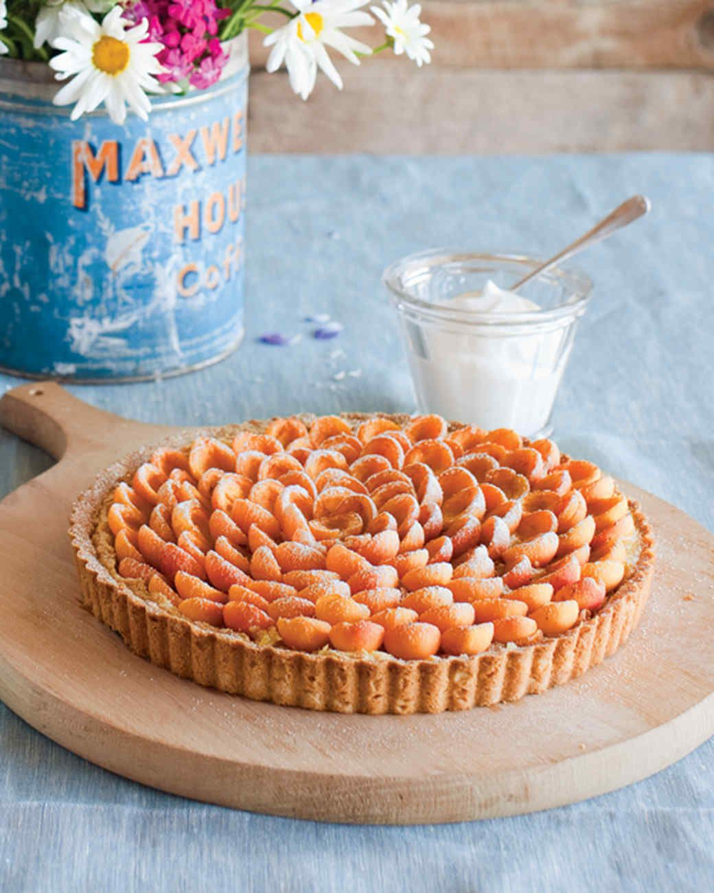 Almond-Apricot Tart with Whipped Cream | Martha Stewart Living - Set up a sweet arrangement on the dessert table with this flower-inspired almond tart topped with rings of fresh apricots.