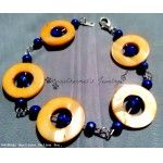 Orange circle bead frames with blue accents bracelet
