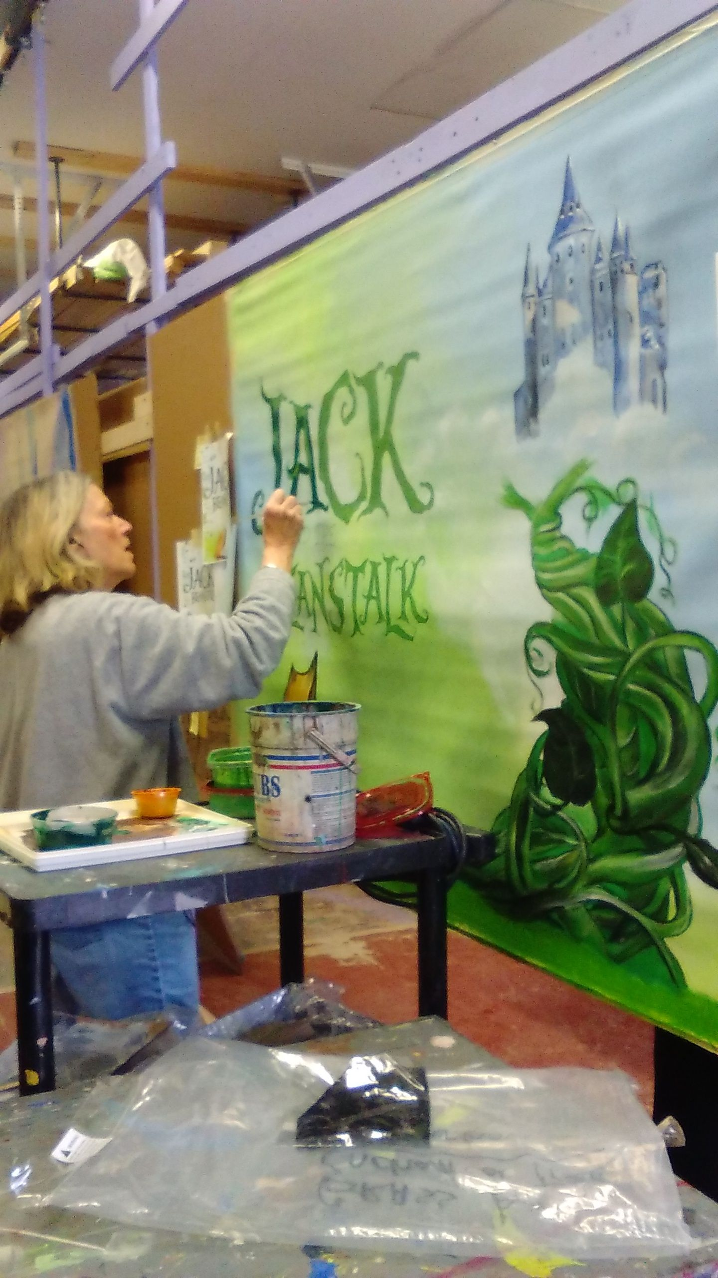 Beverly paints lettering on Jack & Beanstalk page