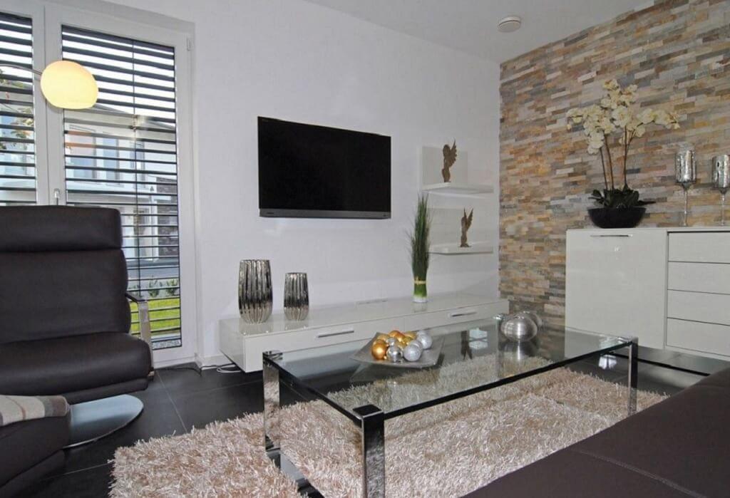 interior wohnzimmer modern wandgestaltung mit steinwand. Black Bedroom Furniture Sets. Home Design Ideas