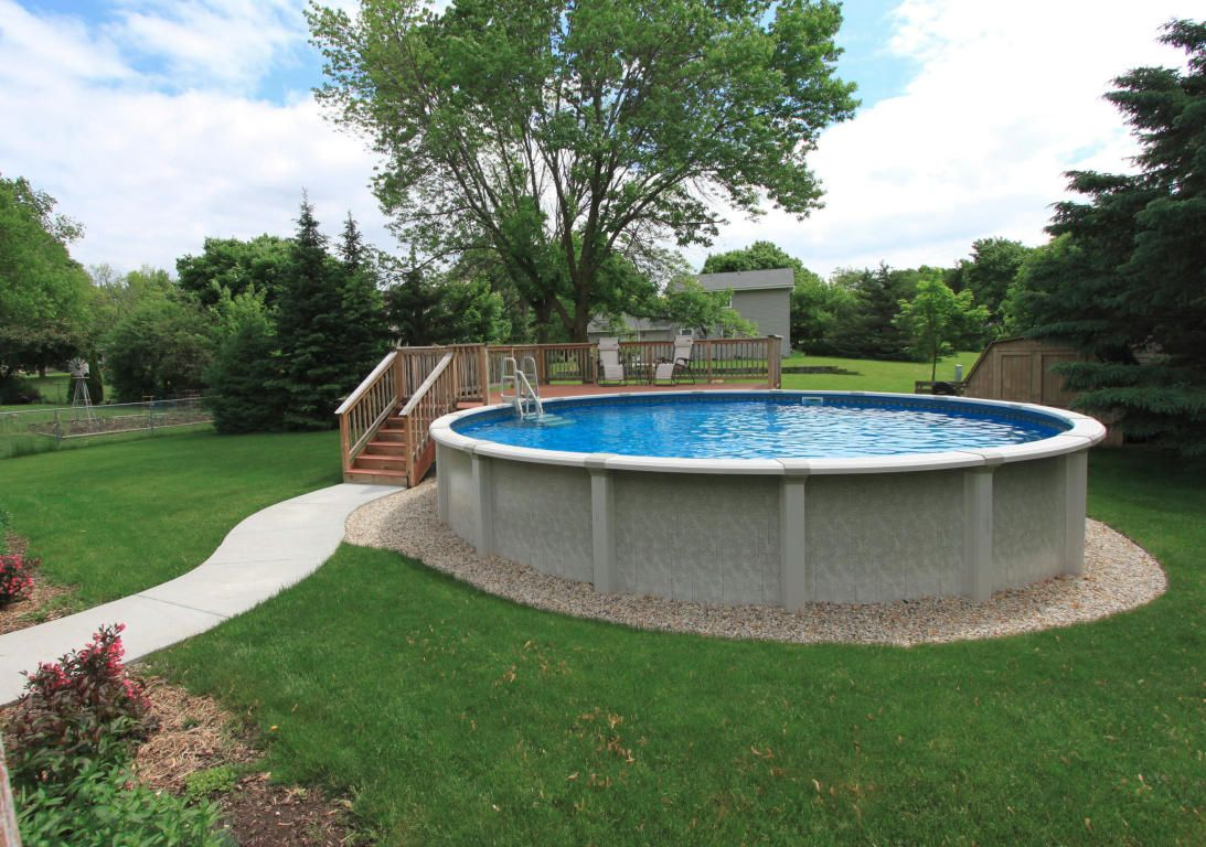 Above ground pool with partial deck and sidewalk for Above ground pool border ideas