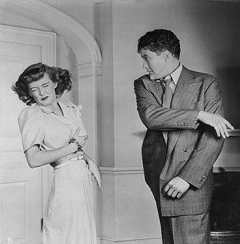 Dennis Morgan Slapping Bette Davis Date Photographed: ca. 1942