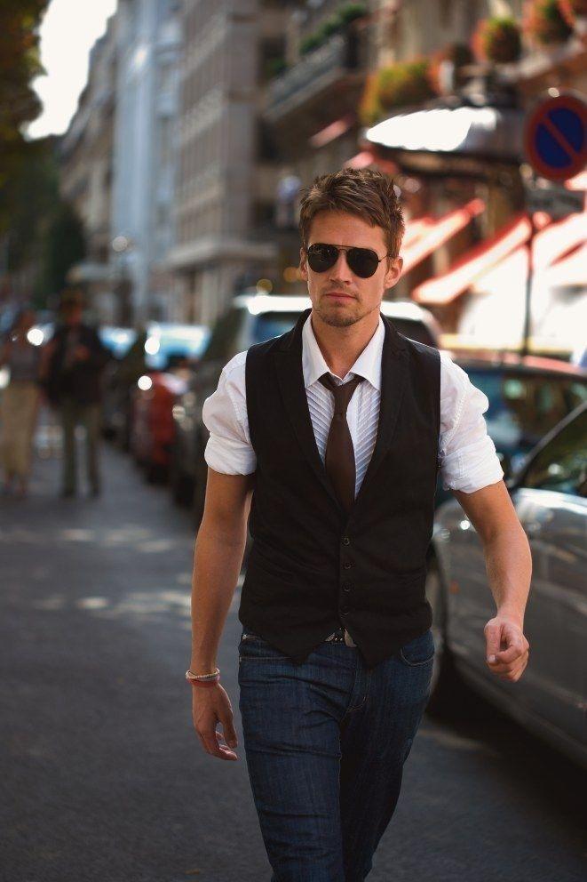 White shirt, black waistcoat, blue jeans, brown tie ...