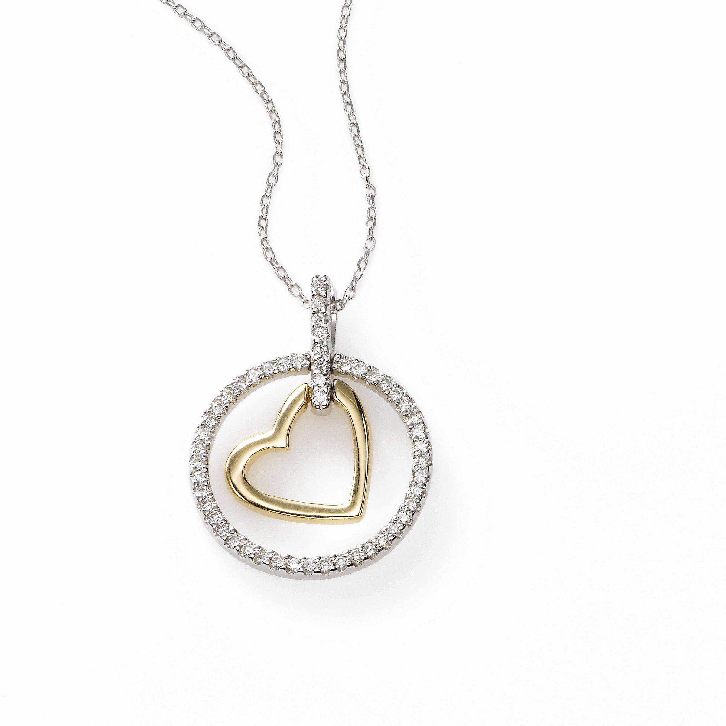 A gleaming circle of diamonds totaling .20 carat surrounds a dangling heart of 14k yellow gold. The dainty pendant is suspended on a bale of diamonds with a delicate 16 inch white gold chain to complete the look. Also available in all white gold.