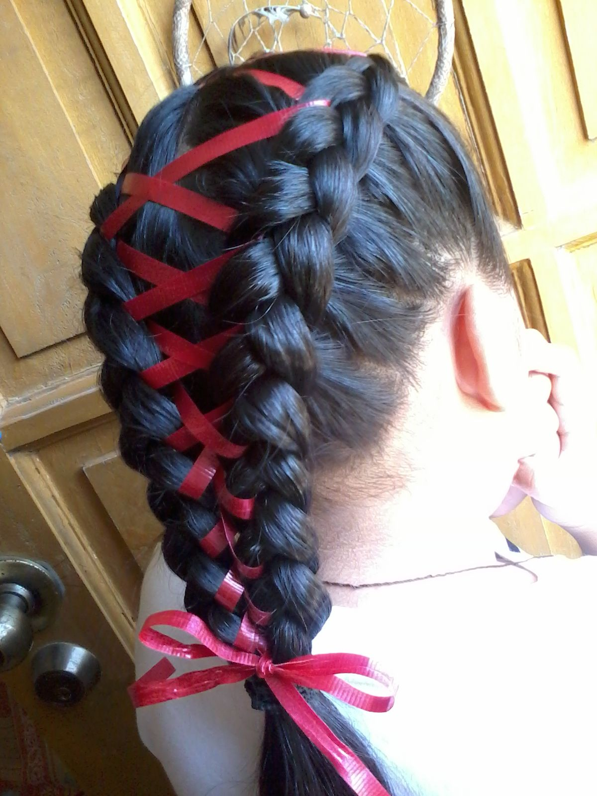 braided hair with ribbon