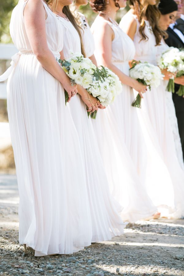 Romantic pale blush bridesmaid dresses: http://www.stylemepretty.com/california-weddings/livermore/2016/02/18/vintage-romance-at-murrietas-well/ | Photography: Jasmine Lee - http://www.jasmineleephotography.com/