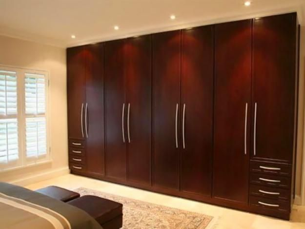 Simple traditional wardrobe brown wooden design ideas for Bedroom wall units with wardrobe for small room