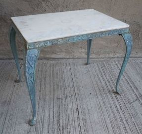 industrial cast iron end table with marble top.