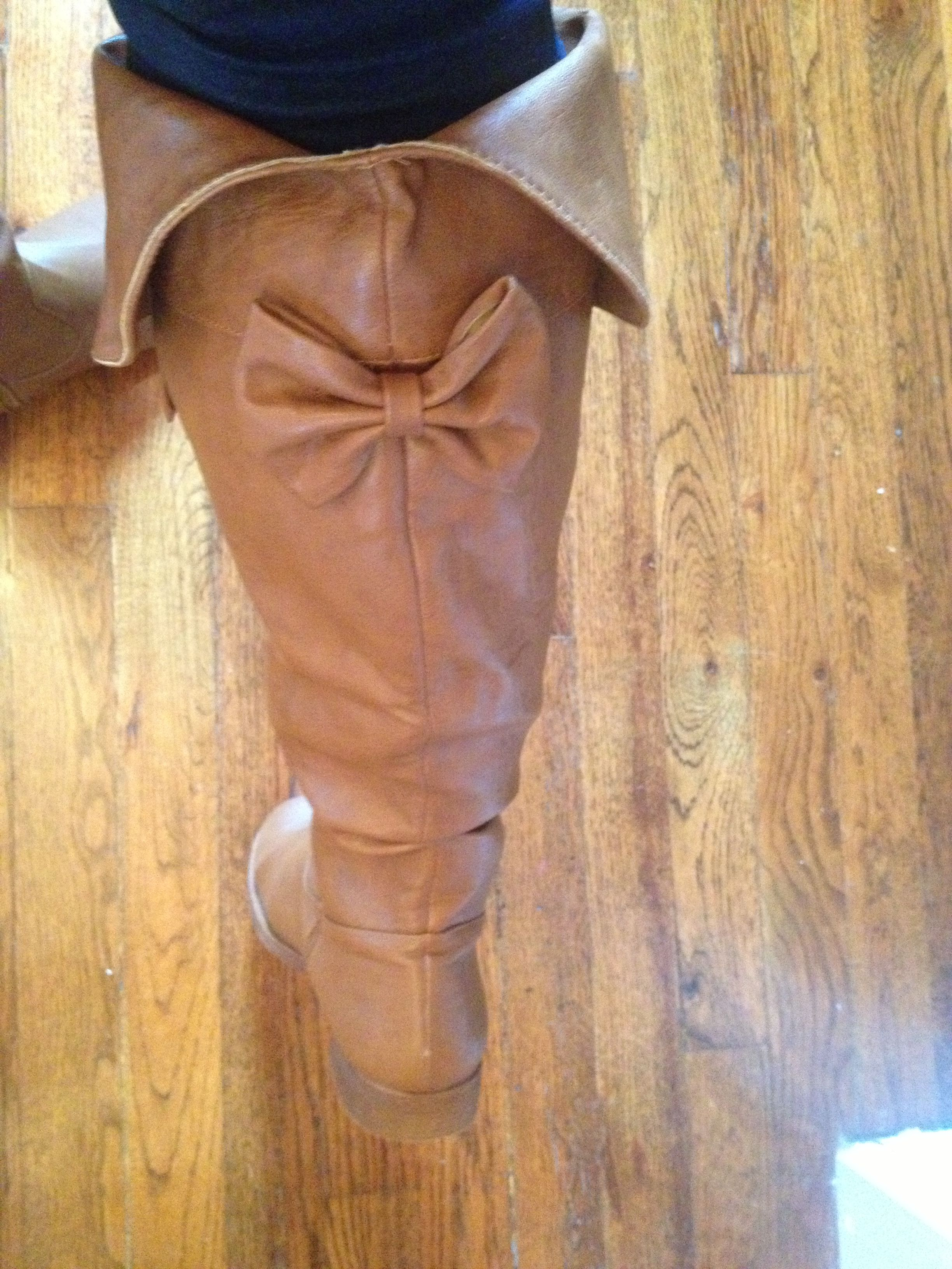Riding boots. Love the bow!