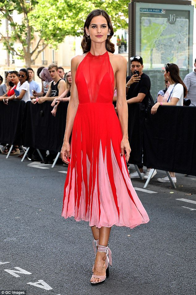 34d40d663b5 Lady in red  Izabel Goulart stunned in a scarlet dress at the Valentino  Menswear Spring Summer 2018 show in Paris on Wednesday