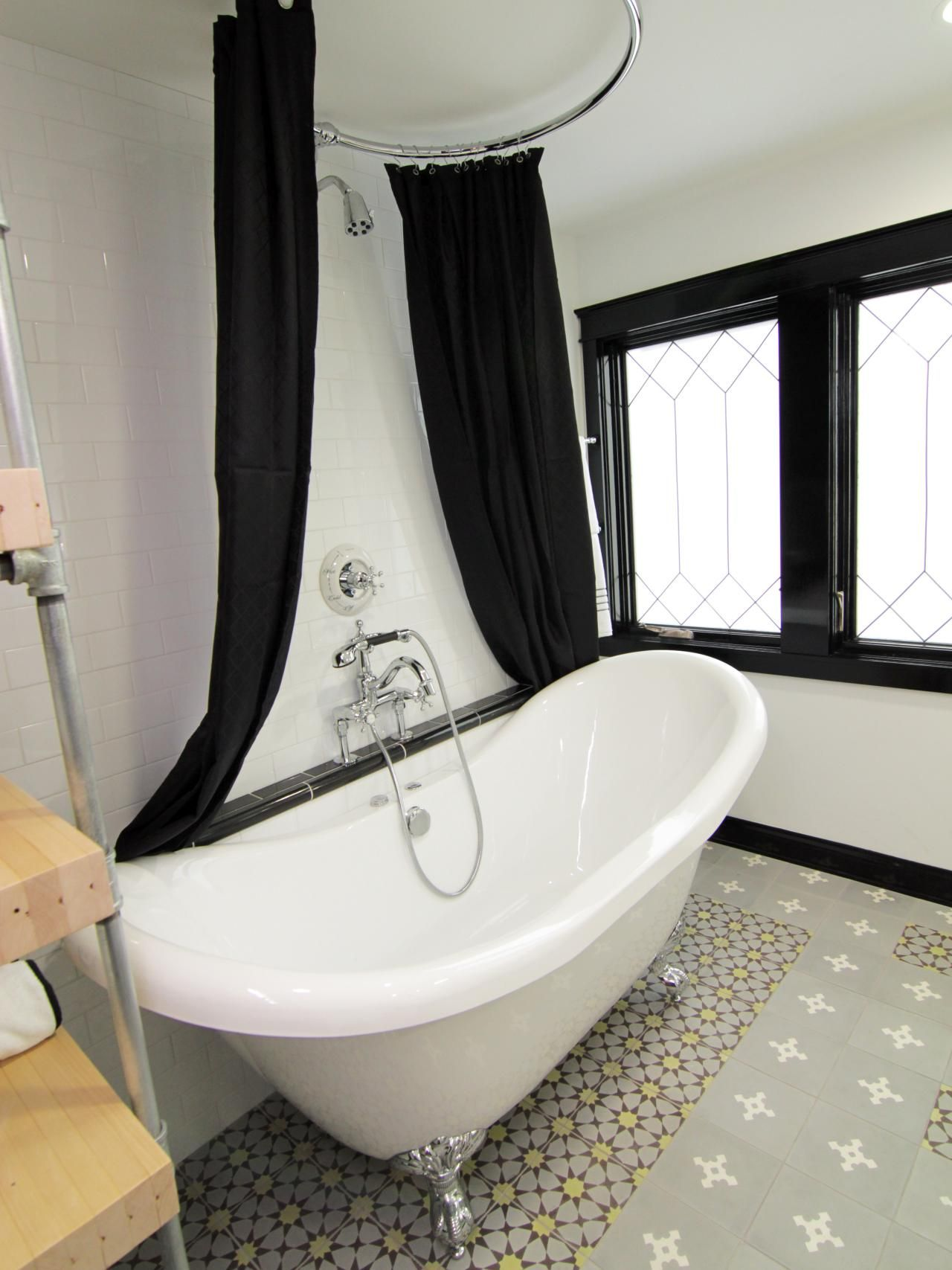 This elegant bathroom features white subway tile with black accents ...