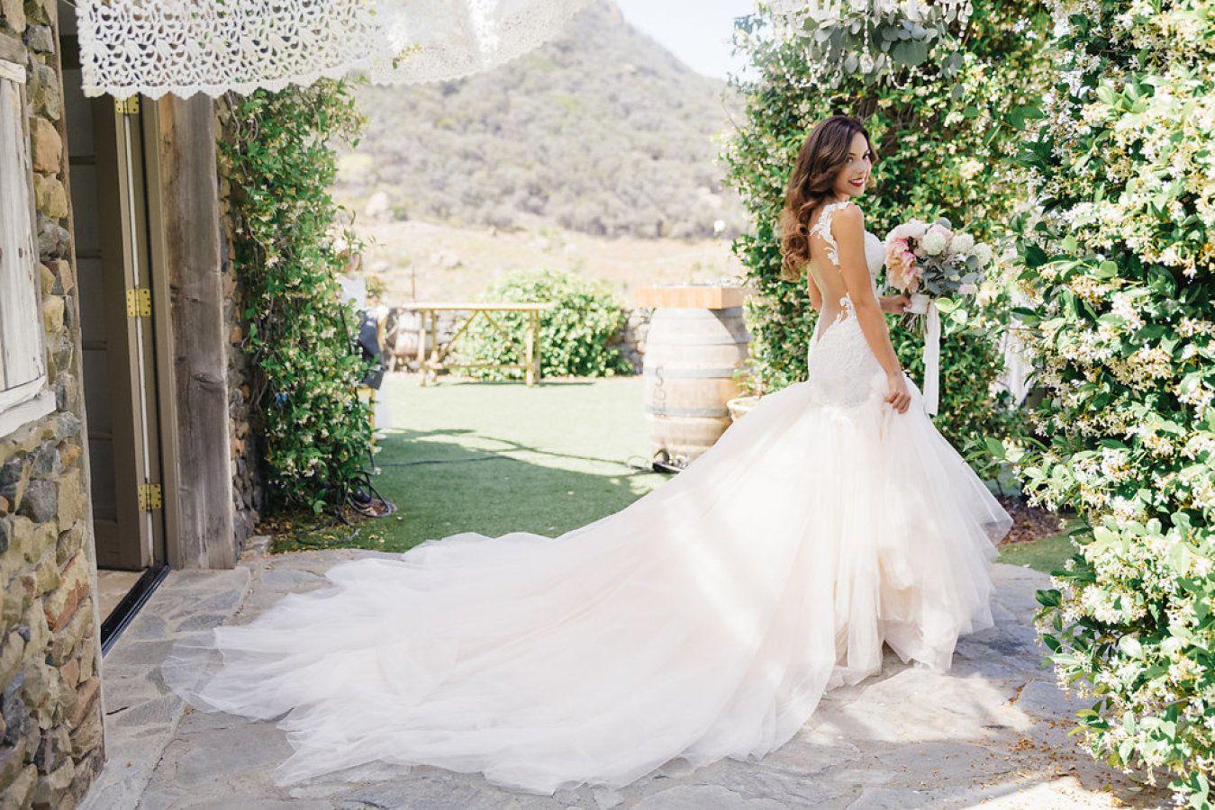 Stunning chiffon train: http://www.stylemepretty.com/2015/09/28/romantic-malibu-vineyard-wedding/ | Photography: Jana Williams - http://jana-williams.com/