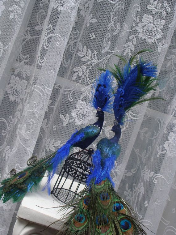 What a fun topper for a Peacock themed Christmas tree ~ Peacock - peacock christmas decorations