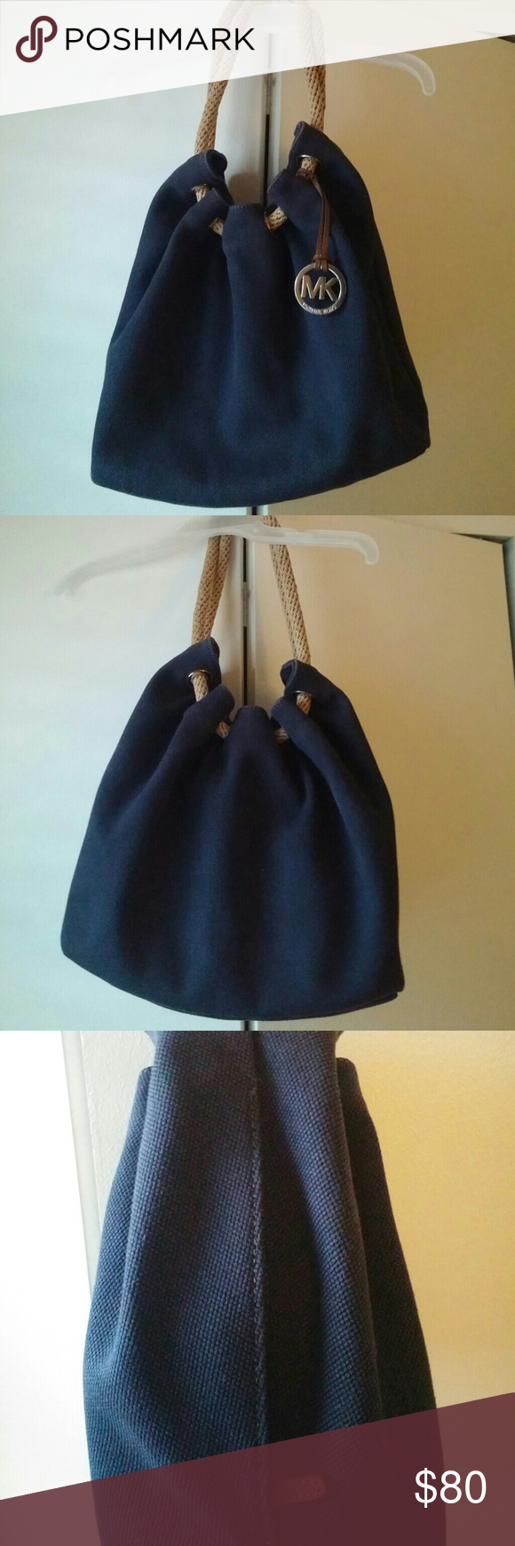 """Michael Kors Marina Navy Large Shoulder purse Measures approximately 15.5"""" tall x 10.5""""w x 6.5 """" deep... Has side zipper pocket & Hang tag... Gently used condition with no signs of age or wear & tear.... Michael Kors Bags Shoulder Bags"""