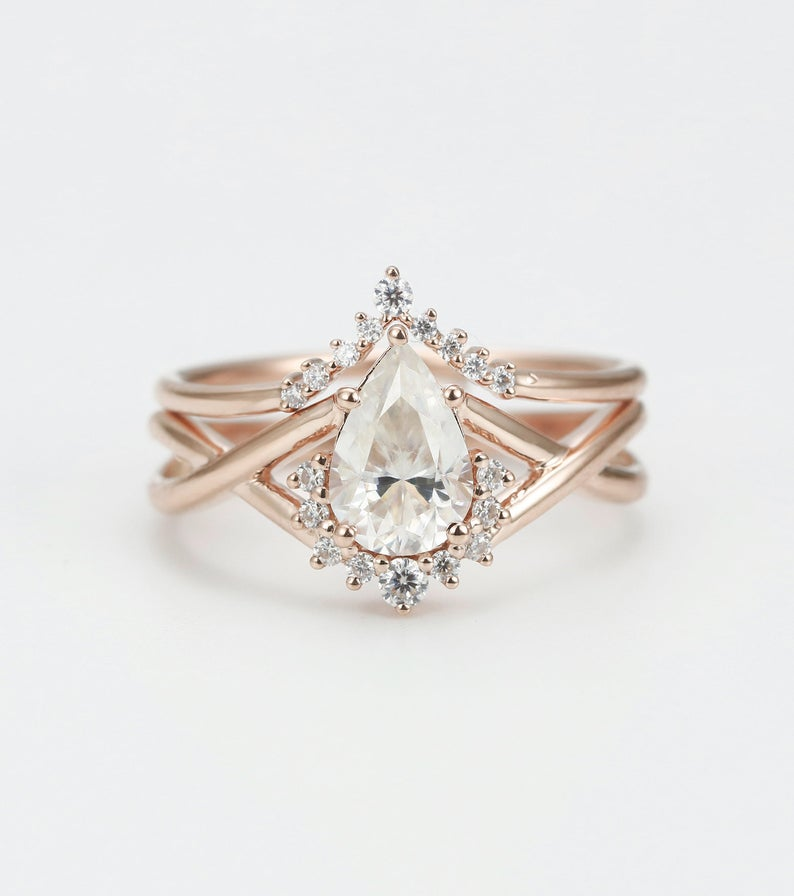 Engagement ring set in Rose gold with Pear shaped