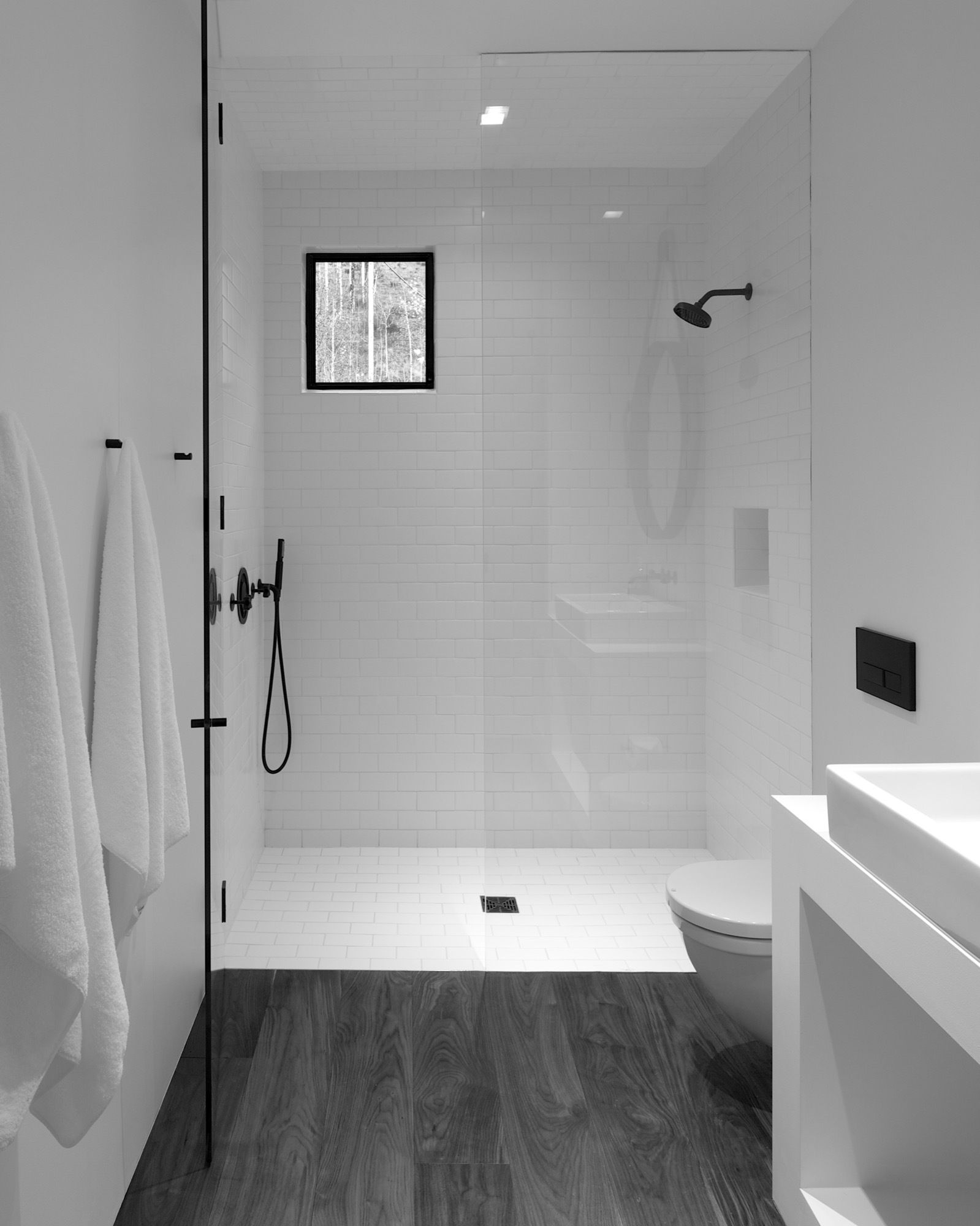 The Minimalistic Bathroom At Center Of Studio Separates Sleeping Area From Living
