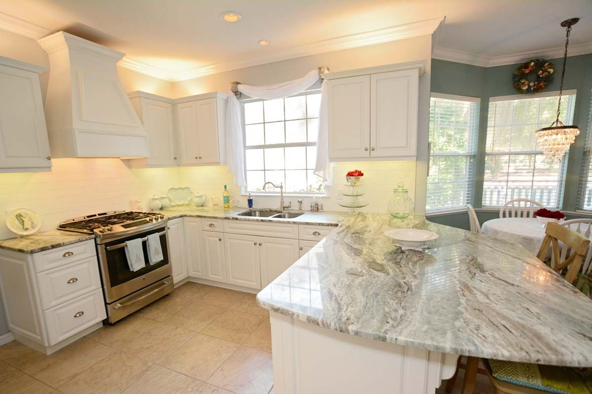 Ordinaire This Is A Remodeled Kitchen HCI Did In Gainesville, FL. The Kitchen  Features White Cabinets With Ocean Beige Granite Countertops And Custom  Cabinetry.