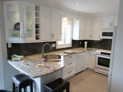Cloud White Cabinetry With Granite 4