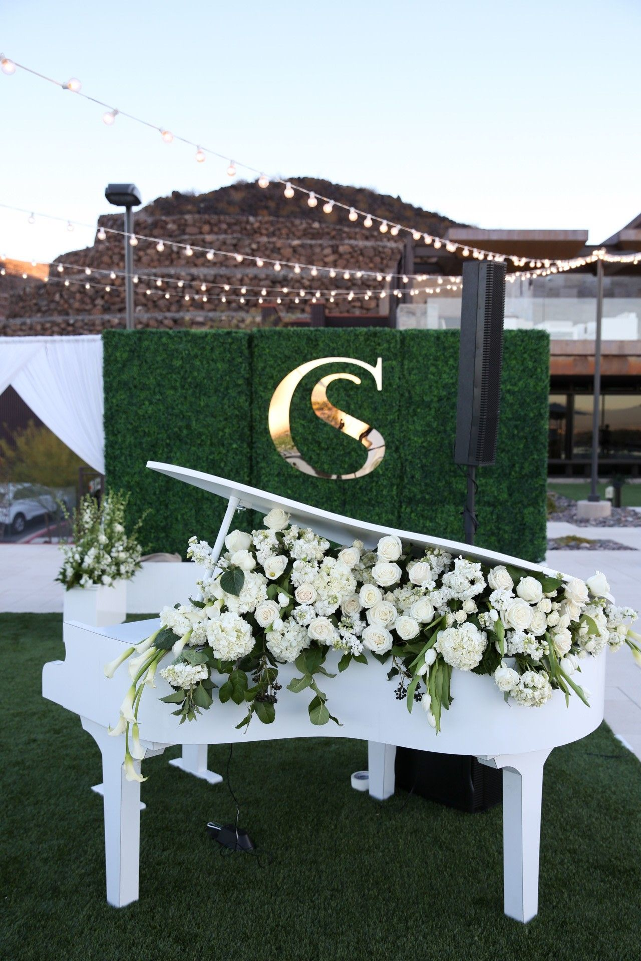Classic Piano with White Roses in front of a Greenery Wall ...