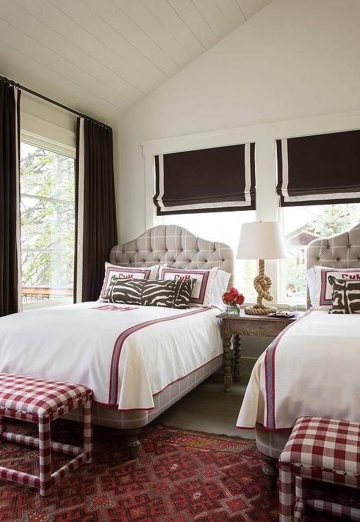 Beautiful Pink and brown girls bedroom boasting a vaulted