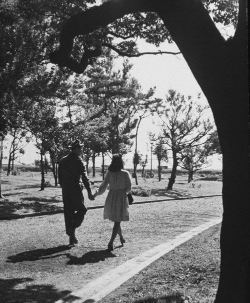 1946. US Soldier and Japanese girlfriend out for a walk in the park.