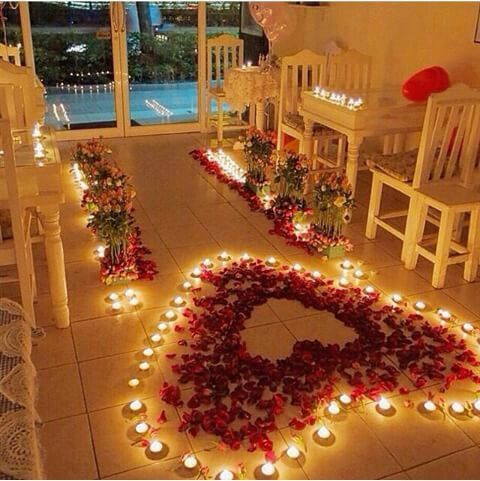 The Romantic Hotel Room Decoration With Real Rose Petals Candles