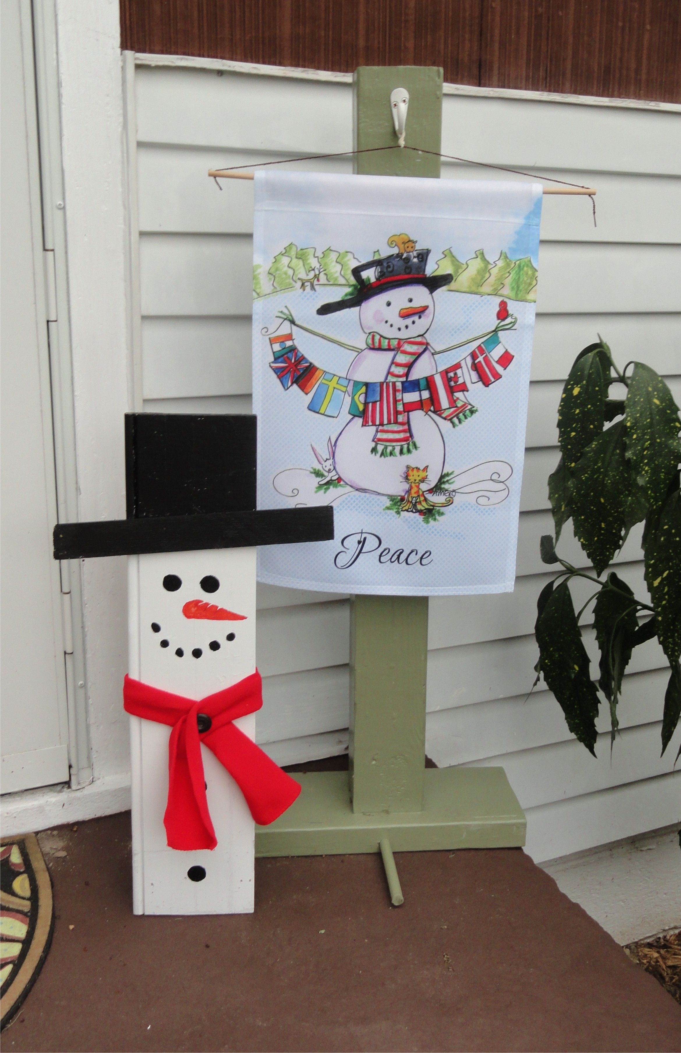 a winter porch idea snowman and flag stand made from scrap wood