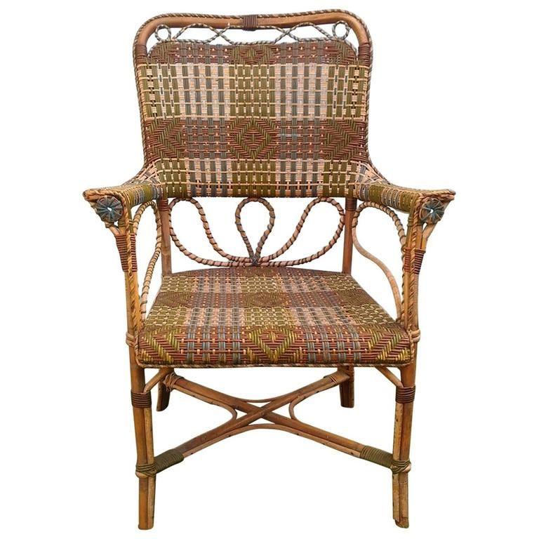 Galerie Vauclair - fauteuil en rotin à motifs géoémétriques #wickers
