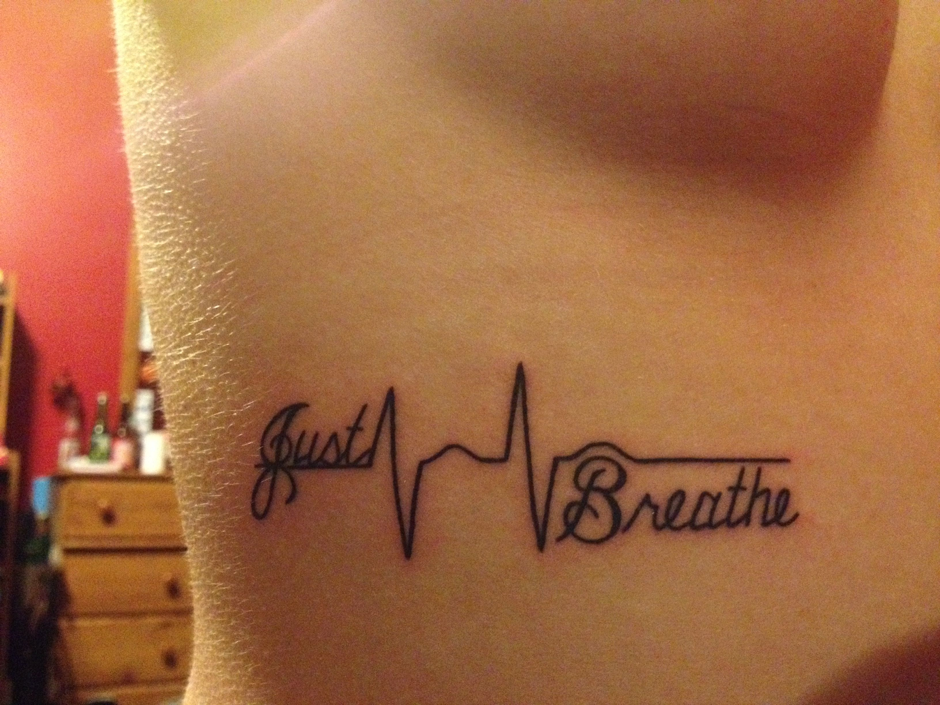 I like this tattoo, I would want mine to say just breathe in between ...