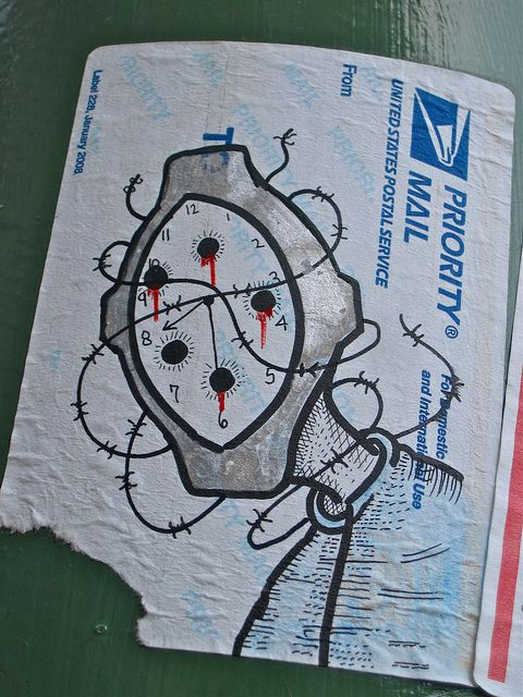 A surrealistic piece of street art drawn on a priority mail sticker as seen in