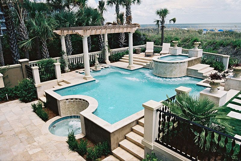 Elevated Pool classic geometric pool with elevated spa, stone decking, waterfall