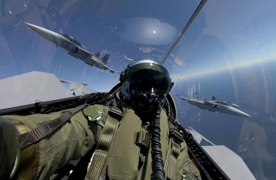 The pilot of a SAAB JAS 39 Gripen taking a self shot       Over 2000 Free FULL Movies and Television - Anton Pictures  www.YouTube.com/AntonPictures