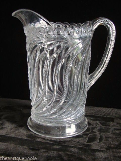 "EAPG ""Beaded Swirl & Disc"" pattern Pitcher made by Bryce Brothers E Liverpool Glass circa 1890-1904, 8 5/8""H x 7.25"" W handle to spout, 4.5W"