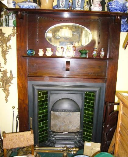 An Edwardian Mahogany Fire Surround Dating From Around