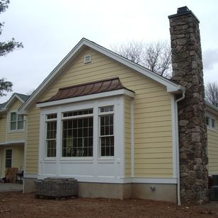 Family room addition featuring walk out box bay window for Box bay windows for sale