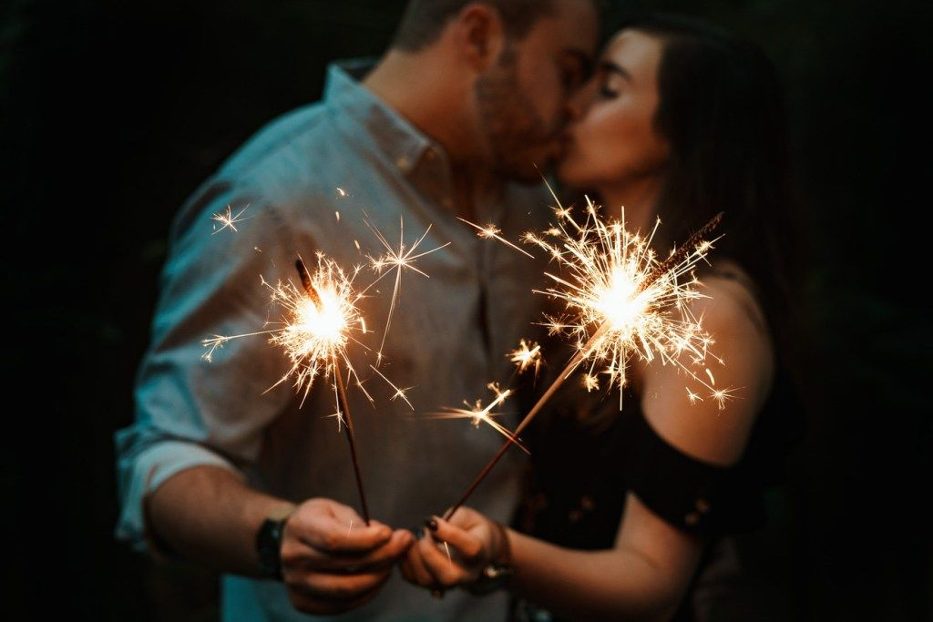 A couple posing while holding sparkles | Twin flame relationship, Twinflame, Twin flame runner
