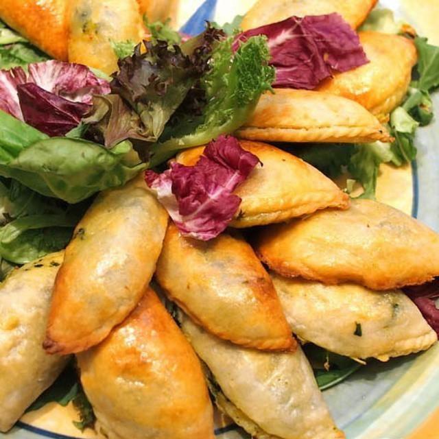 Tiropitakia.. Greek pie stuffed with cheese & vine leaves.. Delish!