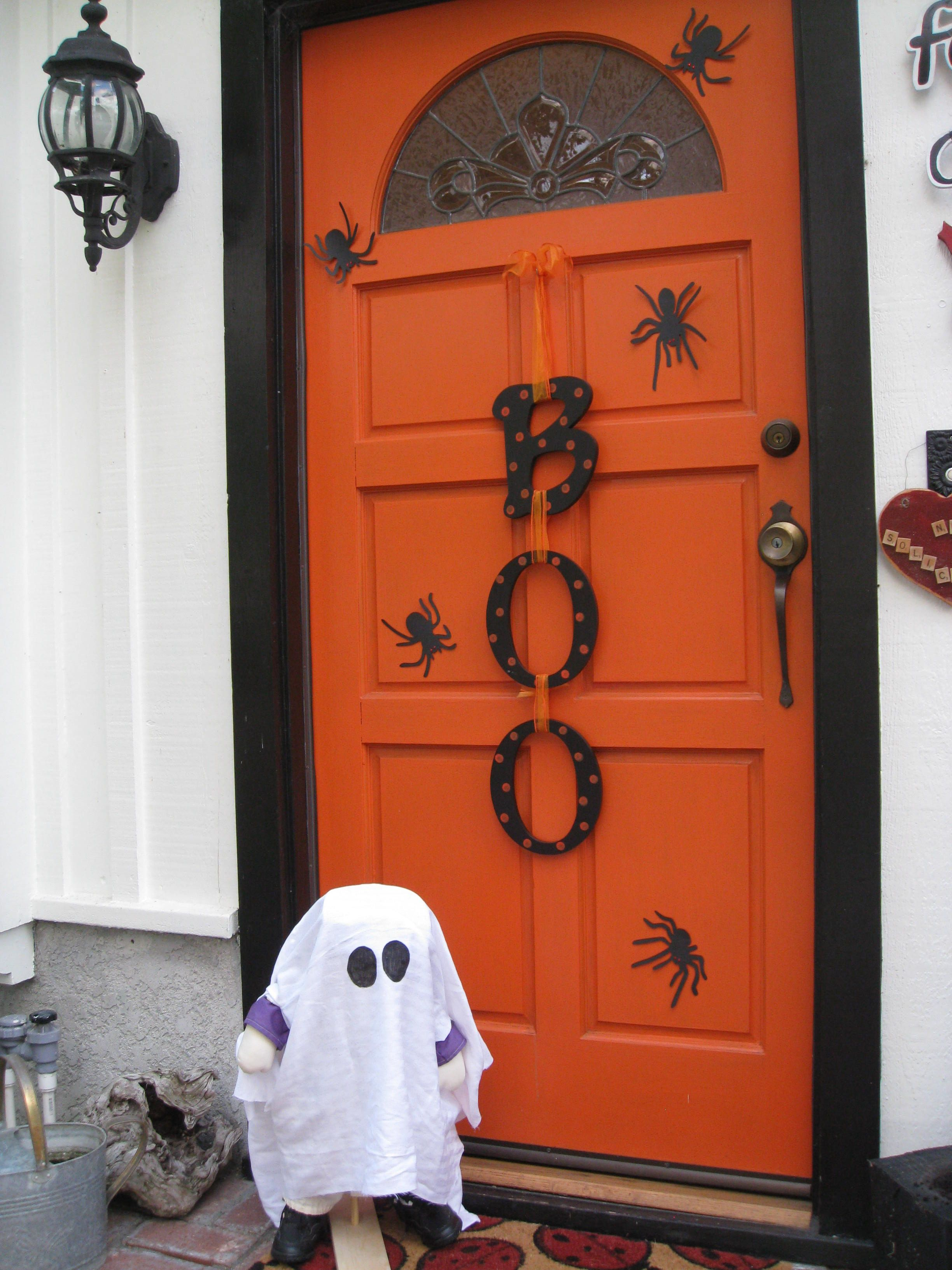 Window decor for halloween  halloween front door gonna do littler spiders and the boo