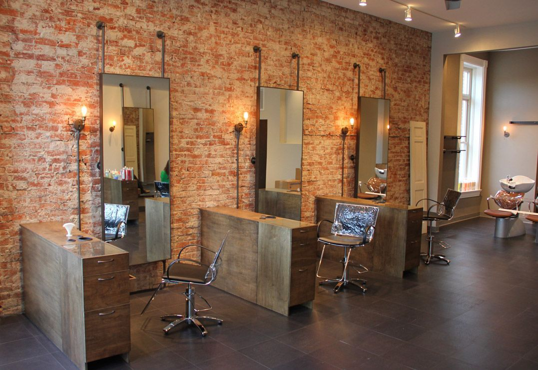 exposed brick wall mounted fixtures with exposed conduit on brick wall id=80511