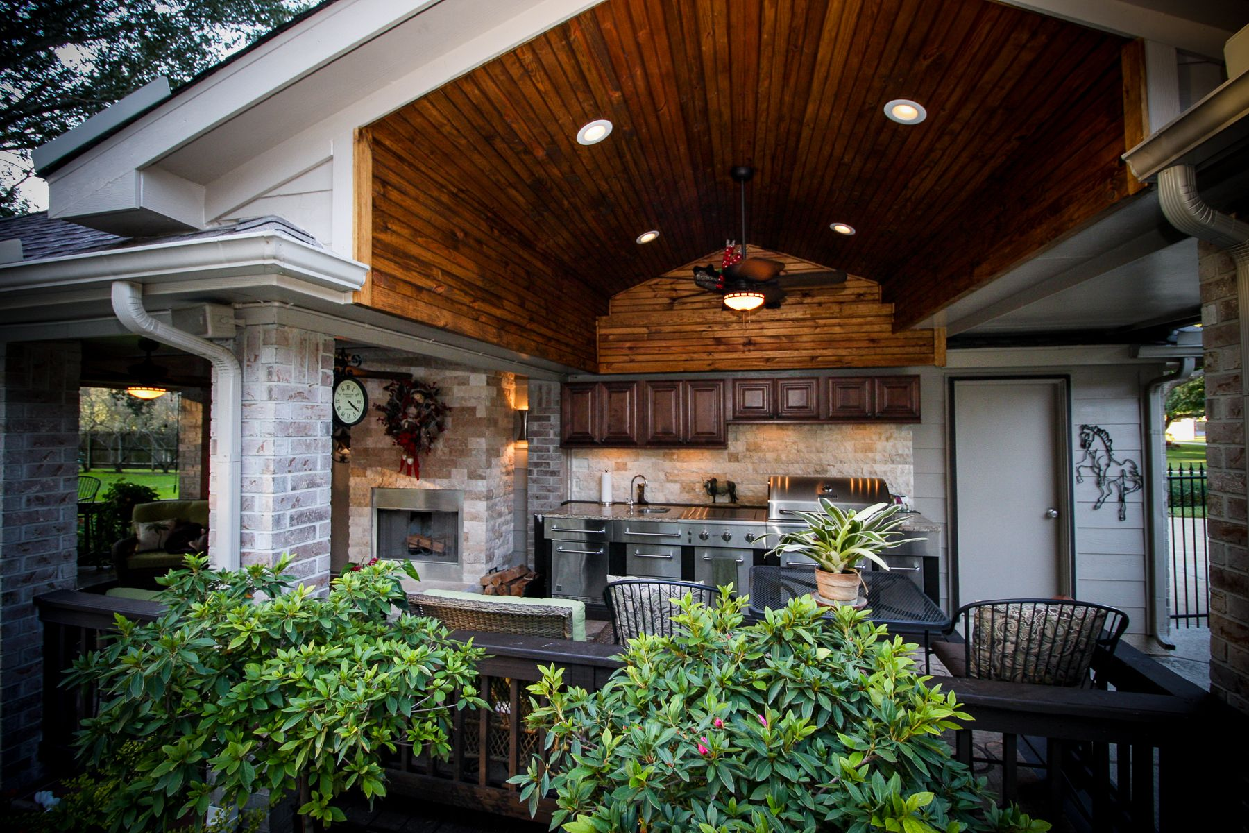 outdoor kitchen patio with natural stone fireplace and wood panel ceiling by griffin constructio on outdoor kitchen natural id=45775