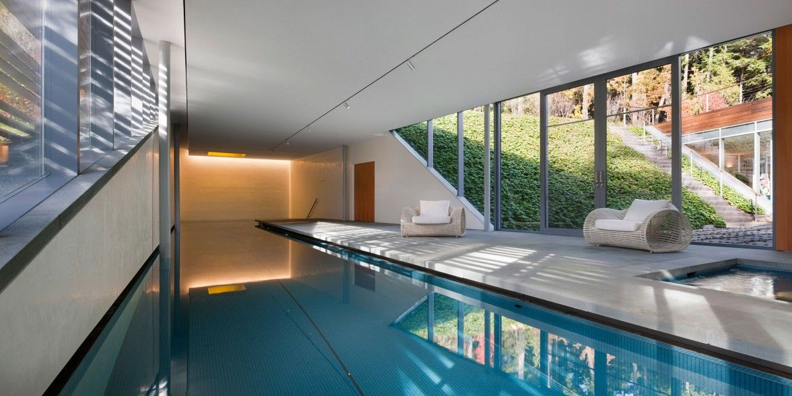 Modern Long Indoor Home Pool Design With Ceiling Track Lighting