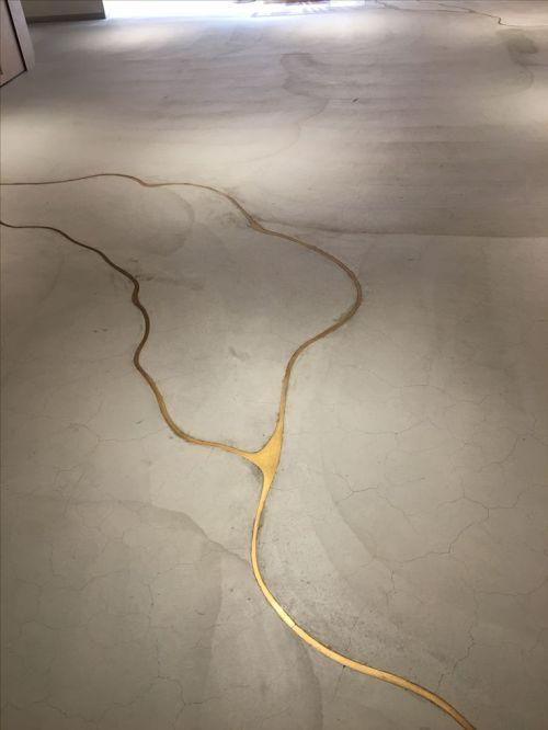 Concrete Floor Cracks Filled With Liquid Gold Resin Kintsugi Concrete Floors Floor Design