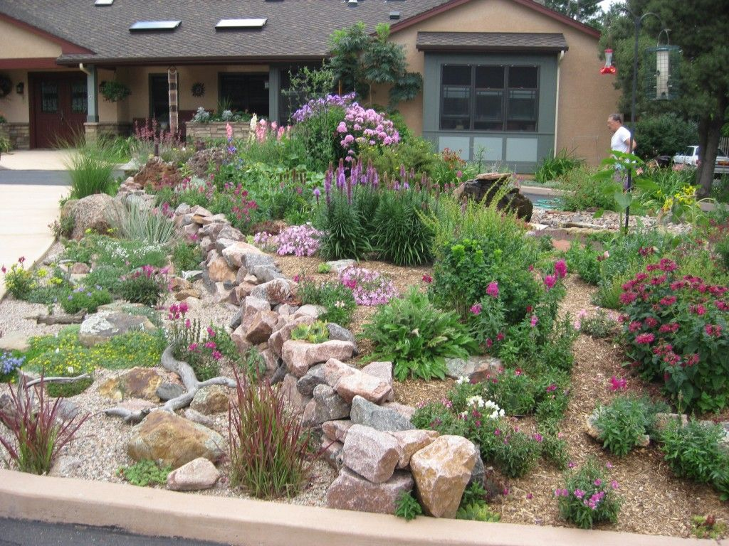 Front yard creative ideas dry creek bed from down spout for Front and backyard landscaping ideas