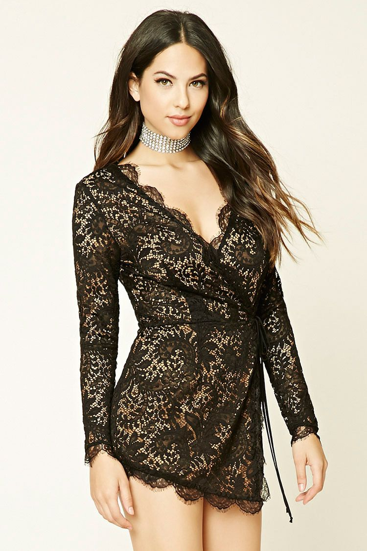 15afe51d8944 A lace romper featuring a wrap-front with self-tie straps