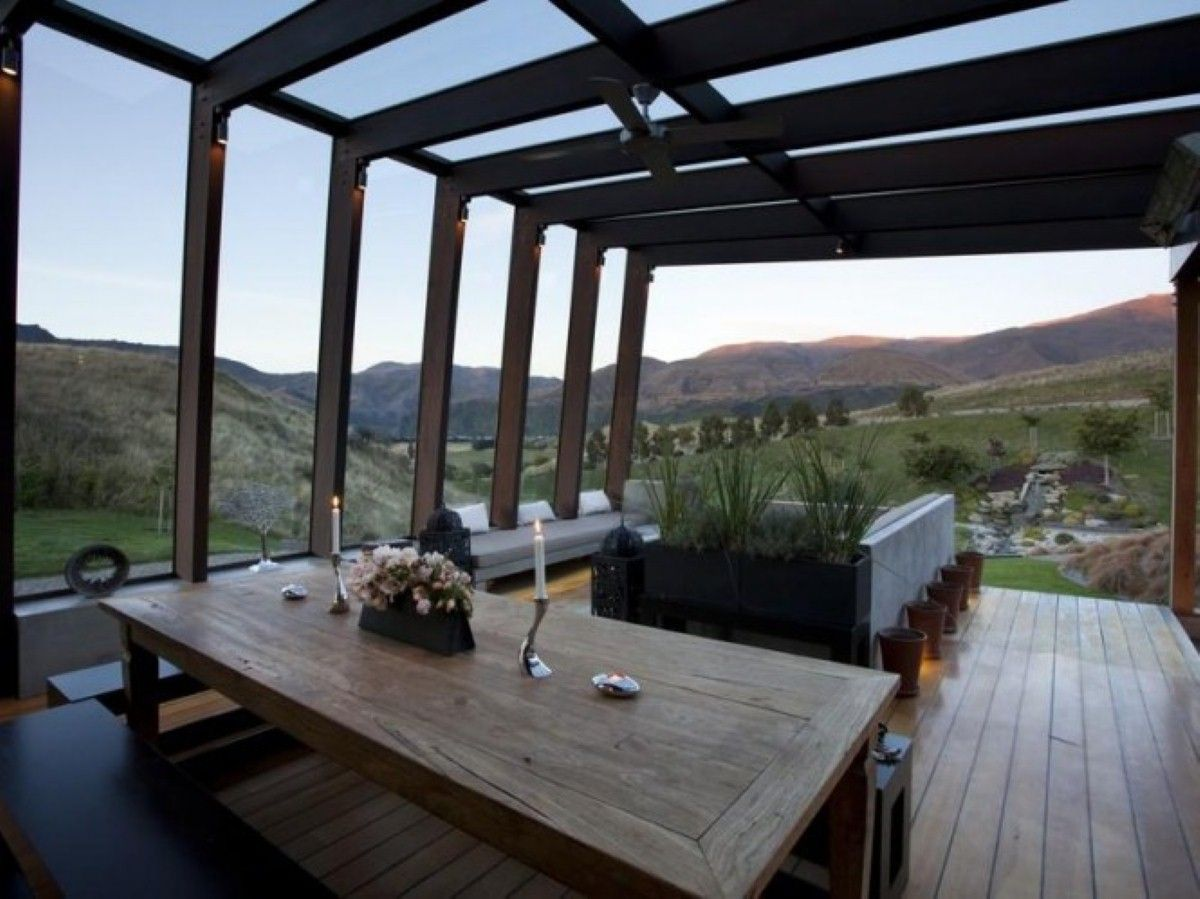 Stunning And Perfectly Peaceful Designer Pad In The Wakatipu Basin: modern pad dining room with romantic candle light also wooden deck and f...