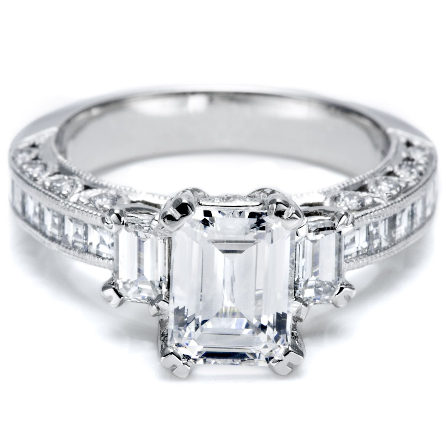 Amazing Tacori emerald cut diamond with two emerald cut side stones and a milligrain accentuated shining streamlined band of channel set princess cut diamonds
